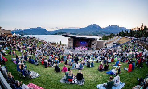 live concert next to a mountain lake