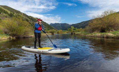 stand up paddleboarding sup on the river near aspen colorado usa