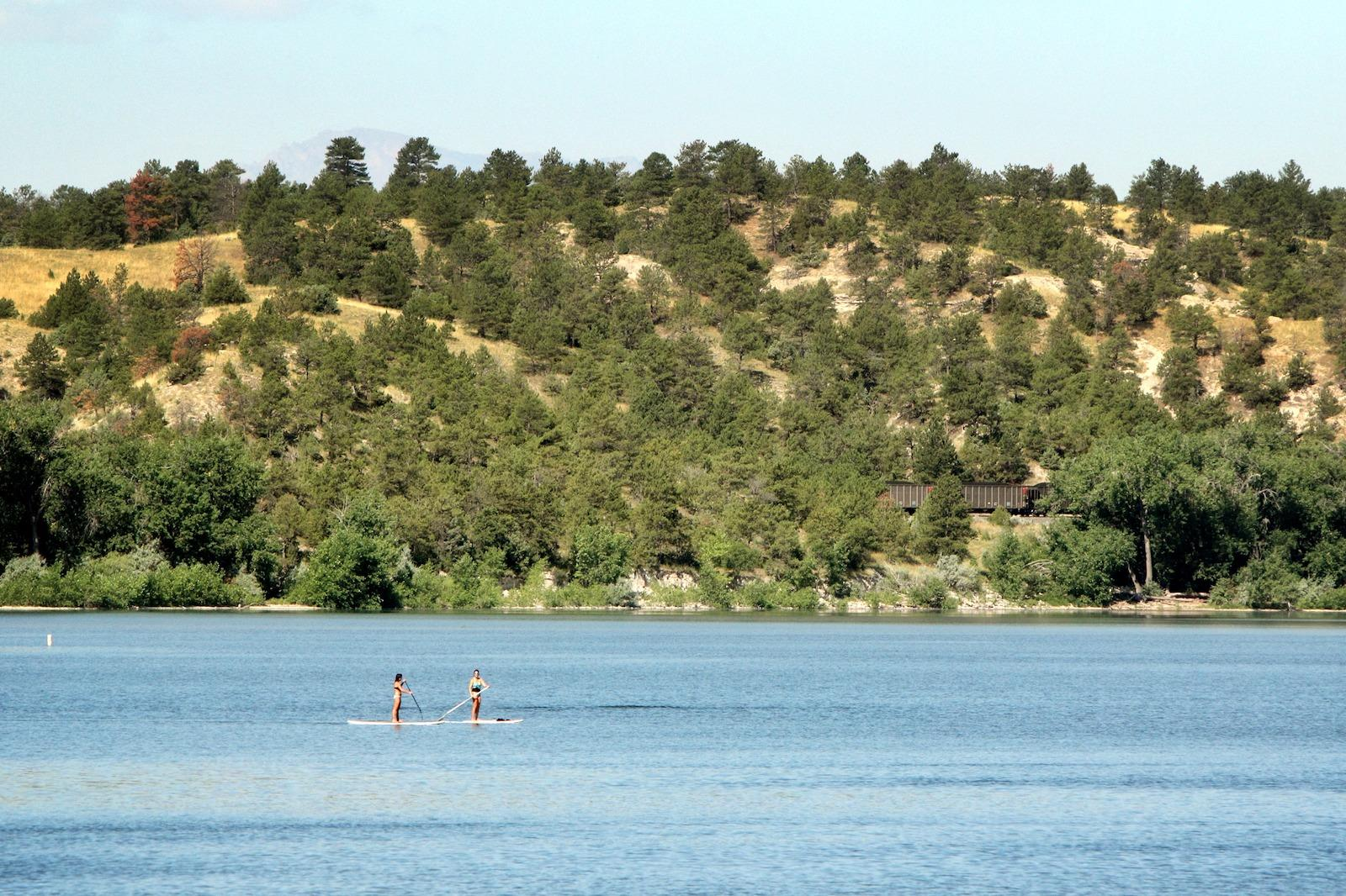 Paddle boarding on family vacation in Platte County, Wyoming
