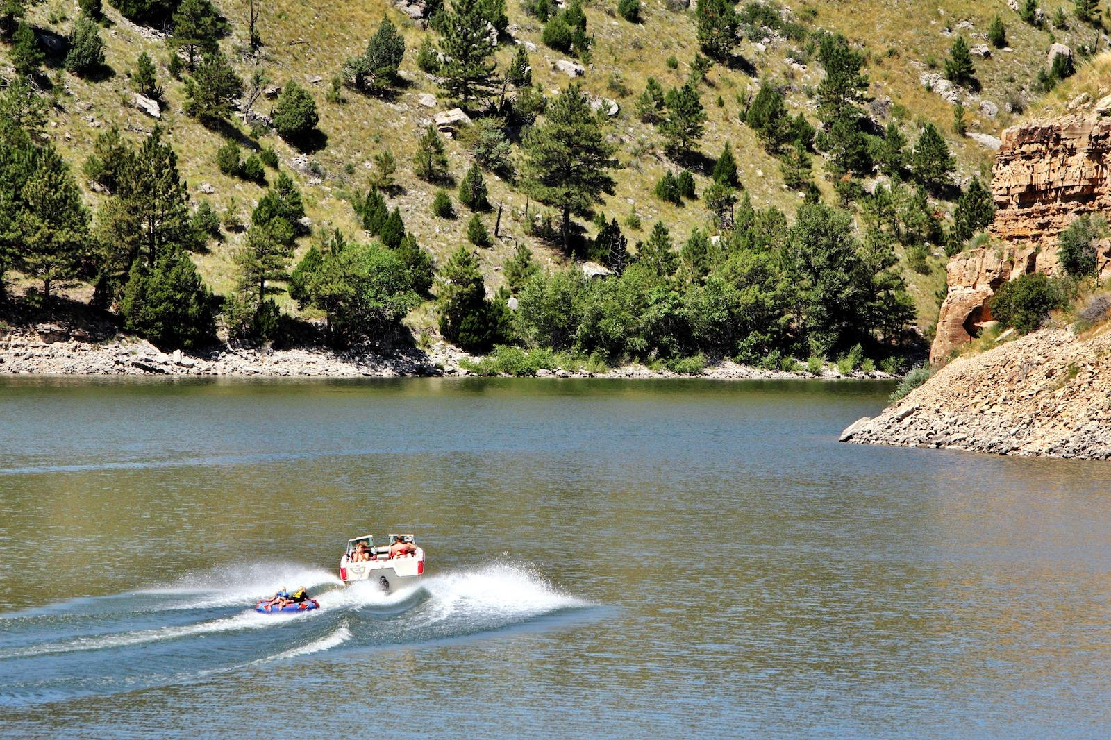 Power boat pulling a tube during family vacation at Guersey State Park in Platte County, Wyoming