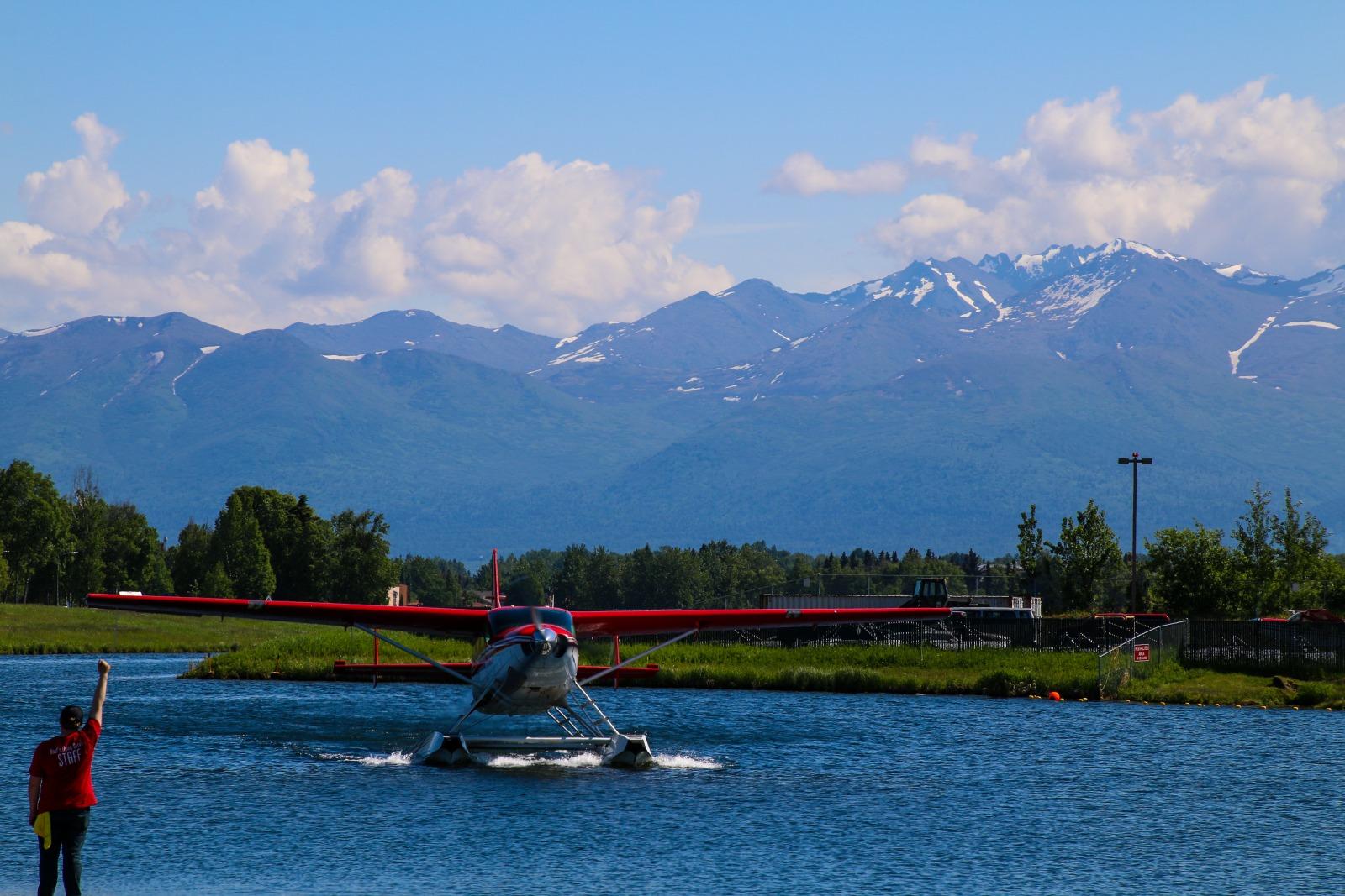 Float plane leaving the water in Alaska.