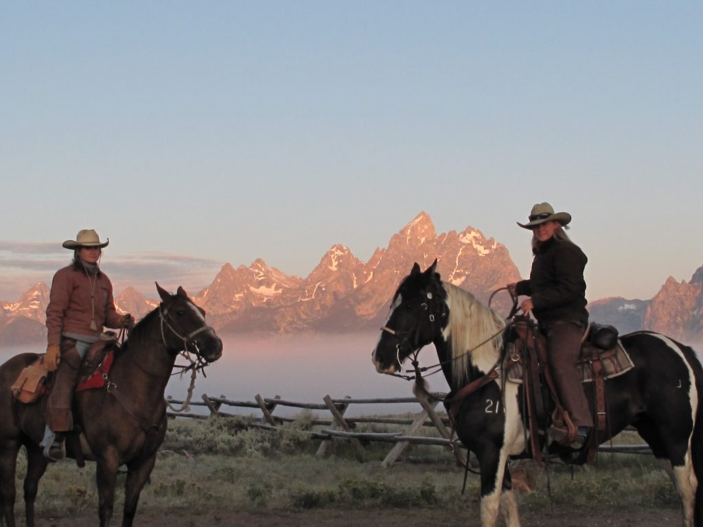 Wranglers in front of the Grand Tetons, Wyoming.