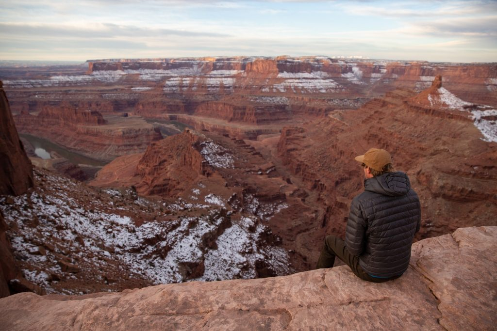 Looking out over Deadhorse Point State Park at sunrise on a trip to Utah national parks in winter