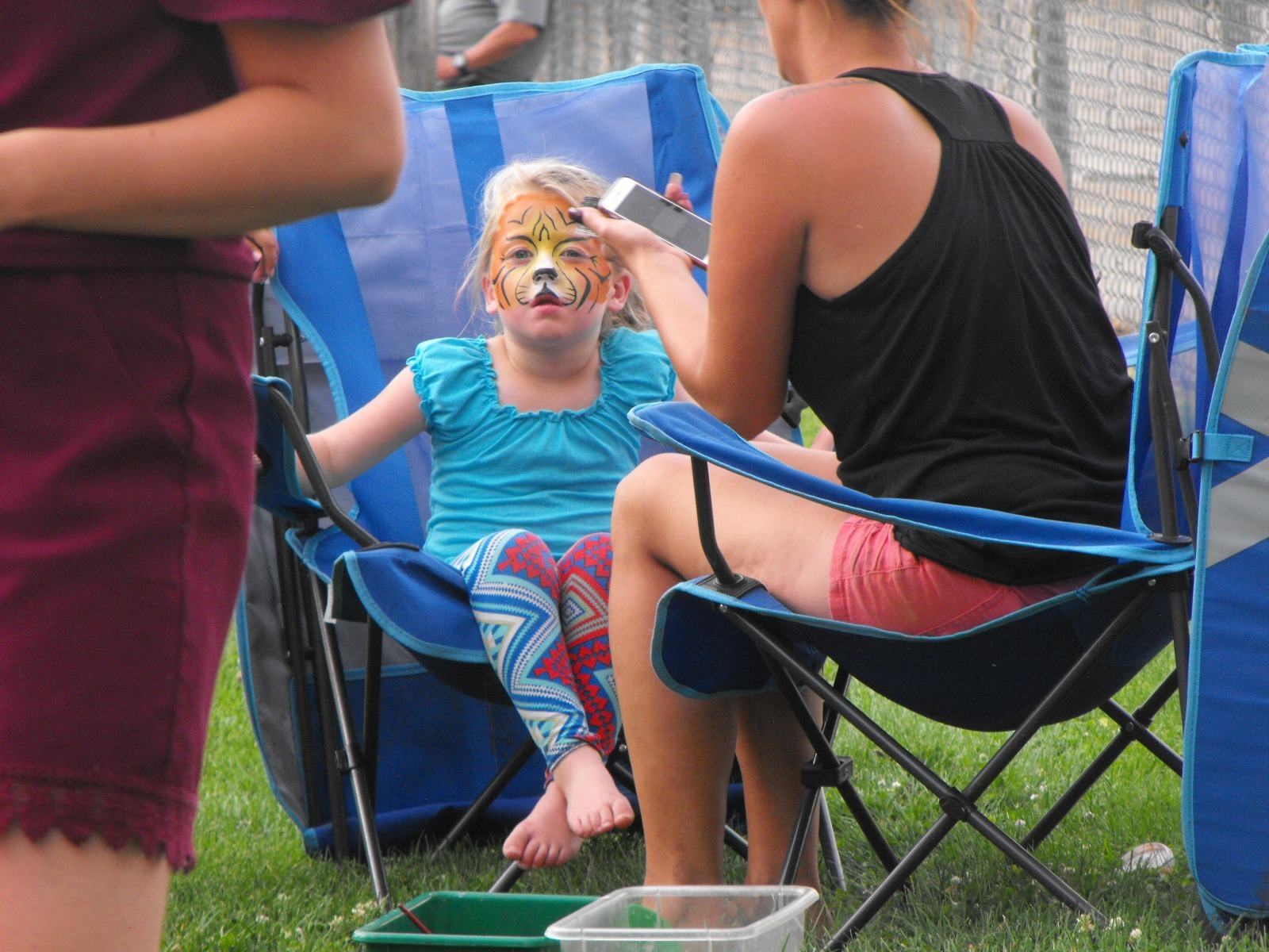 Girl getting face painting at one of Riverton Wyoming's many events